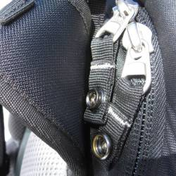Industrial zippers at main compartment with snaps to prevent zipper crawl.