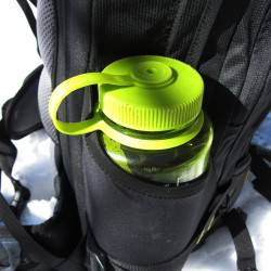 Open pouches at compression straps.