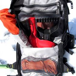 Avalanche gear / safety gear compartment. Three interior mesh pockets, probe sleeve, and shovel head pouch. Compartment is waterproof fabric against other compartments.